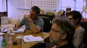 Hart making notes in Bones Writers' Room